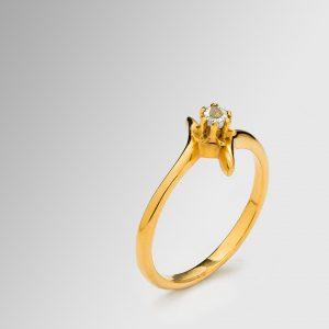 Bague en or sertie d'un diamant non-taillé